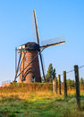 Dutch windmill typical landscape Stock Photos