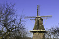 Dutch windmill in vilsteren the netherlands with willows in front Royalty Free Stock Photos