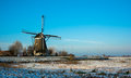 Dutch windmill in winter landscape Royalty Free Stock Photos