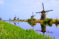 Dutch windmills of kinderdijk with canal reflections at netherlands Royalty Free Stock Photo