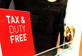 Duty free a red white sign saying tax and and merchandise on the background Royalty Free Stock Photography