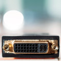 Dvi input connector digital video interface pc cable on defocused turquoise background tilt shift lens used to accent the Stock Photos