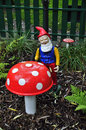 Dwarf and toadstool Royalty Free Stock Photo