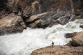 Dwarfed by the river a hike is sheer size of center rapid in tiger leaping gorge on a major tributary of yangtze in yunnan Stock Photography