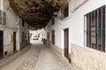 Dwellings built into rock setenil de las bodegas street with overhangs above the rio trejo spain Stock Image