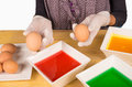 Dyeing easter eggs hands with gloves getting ready to dye Stock Photo