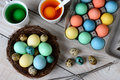 Dying easter eggs horizontal high angle view of egg dyed in a nest with in dye solution and other ready to be dunked Royalty Free Stock Photo
