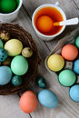 Dying easter eggs vertical high angle view of dyed in a nest with in dye solution format on a rustic farmhouse style Stock Images