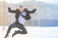 Dynamic businessman jumping outdoor Royalty Free Stock Photo