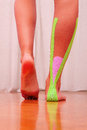 Dynamic functional bandage with taping on woman leg Stock Photos