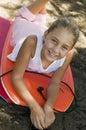 Dziewczyny lying on the beach na taniec boogie deskach Zdjęcia Royalty Free