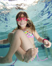 Dziewczyny szczęśliwy mały basenu underwater Fotografia Stock