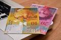 E banking online shopping schweizer franken swiss francs on laptop bills Stock Photo