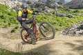 E bike rider uphill trail Royalty Free Stock Photo
