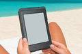 E book reader at the beach Royalty Free Stock Image