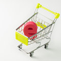 E commerce online shopping concept with letter inside miniature shopping cart Stock Photos