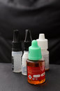 E juice for electronic cigarette closeup shot of liquid Royalty Free Stock Photography