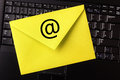 E mail concept yellow letter on laptop keyboard with an at symbol Royalty Free Stock Photos