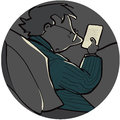 E reader man in bed in dark reading an Stock Photo