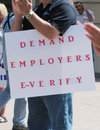 E verify sign demand employers fair federation for american immigration reform held a rally in omaha nebraska on speakers included Stock Photography