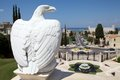 Eagle made by white marble at the bahai garden with haifa cityscape in the background haifa israel Stock Photos