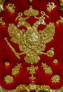 Eagle with scepter and orb double state emblem of tsarist russia on red Stock Images