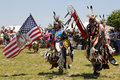The eagle staff leads the grand entry at the nyc pow wow new york june in brooklyn a is a gathering and heritage Stock Image