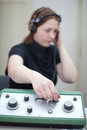 Ear exam with headphones woman having an Stock Photography