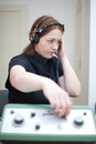 Ear exam with headphones woman having an Stock Photos