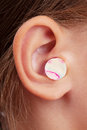 Ear plugs in the human ear Stock Image