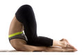 Ear pressure pose sporty fit beautiful young woman in sportswear working out doing variation of plow posture yin yoga snail Stock Images