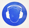 Ear protectors sign at a construction site Royalty Free Stock Photos