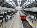 Earls court tube station in london uk circa august train arrives at underground Stock Photos