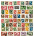 Early canadian postage stamps page from a stamp collection of Royalty Free Stock Photo