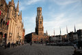 Early evening in grote square of showing the belfry the is filled with people taking an stroll Royalty Free Stock Image