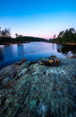 Early fall morning by forest lake with clear blue sky Royalty Free Stock Images