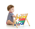 Early learning baby boy with counter Stock Image