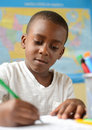 Early learning a young boy in school doing his work Royalty Free Stock Image