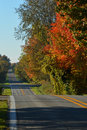 Early morning country road fall color on a hilly farm Stock Photo