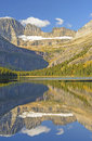Early morning fall reflections on a mountain lake josephine in glacier national park in montana Stock Photography