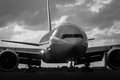 Early morning jet airliner on runway commercial aircraft in front view Stock Photography