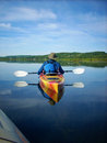 Early morning kayak on a peacful lake Royalty Free Stock Photography