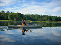 Early morning kayak on a peacful lake Royalty Free Stock Photo