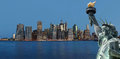 Early morning new york city skyline panorama symbols of manhattan and the statue of liberty Royalty Free Stock Images