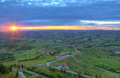 Early morning and sunrise over hill of piedmont italy aerial view on green hills vineyards langhe under cloudy sky rising sun in Royalty Free Stock Photo