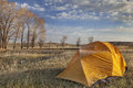 Early spring camping in wyoming a tent covered by frost morning next to stand of cottonwood north platte river valley Stock Photos
