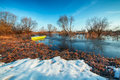Early spring landscape with wooden boat Royalty Free Stock Photography
