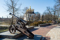 Early spring time park with the cannon and church Royalty Free Stock Photo