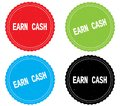 EARN CASH text, on round wavy border stamp badge. Royalty Free Stock Photo