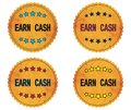 EARN CASH text, on round wavy border vintage, stamp badge. Royalty Free Stock Photo